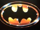 Man throws Batman weapon at cop car