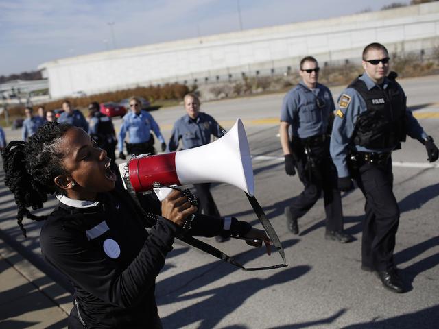 Image result for Michael Brown sparks protests.