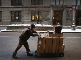 FedEx, UPS try to avoid last year's delays
