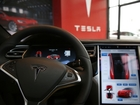 Investigators: Tesla speeding at time of crash