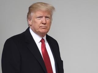 Trump backs off wall-funding demand